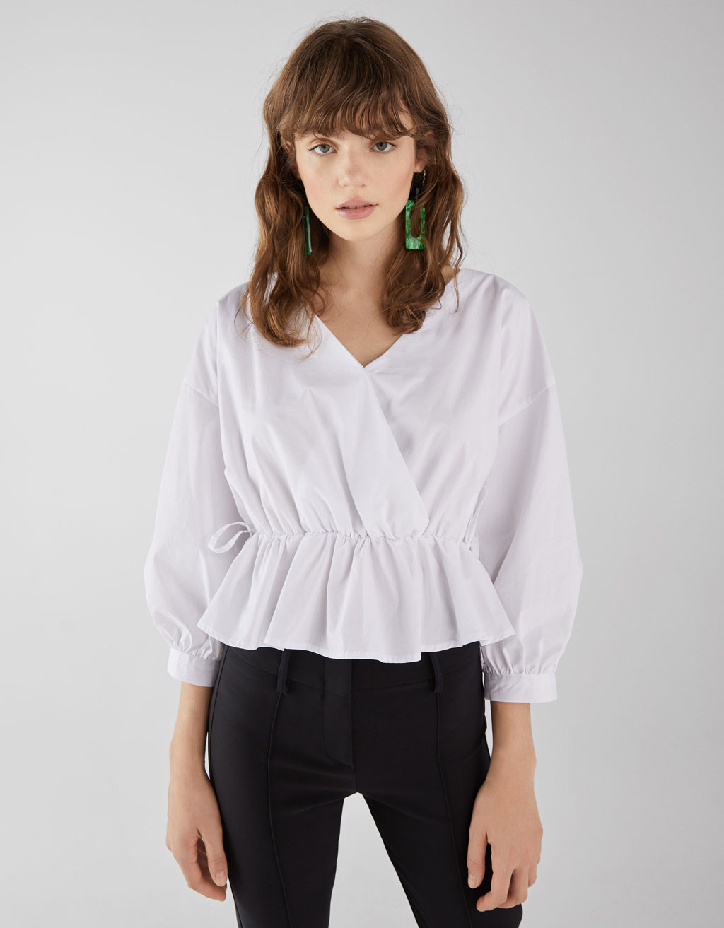 Shirt with a gathered waist