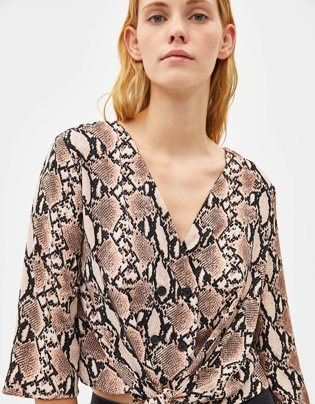 Snakeskin print knotted shirt