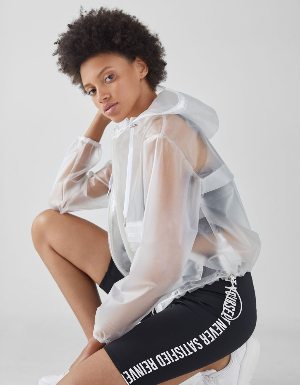 Blouson transparent à carreaux