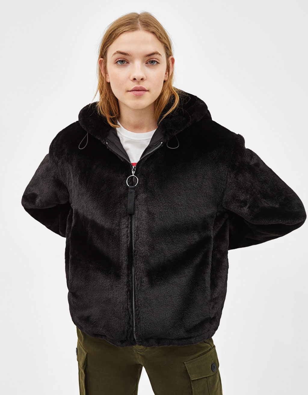 Faux fur jacket with hood and stripes.