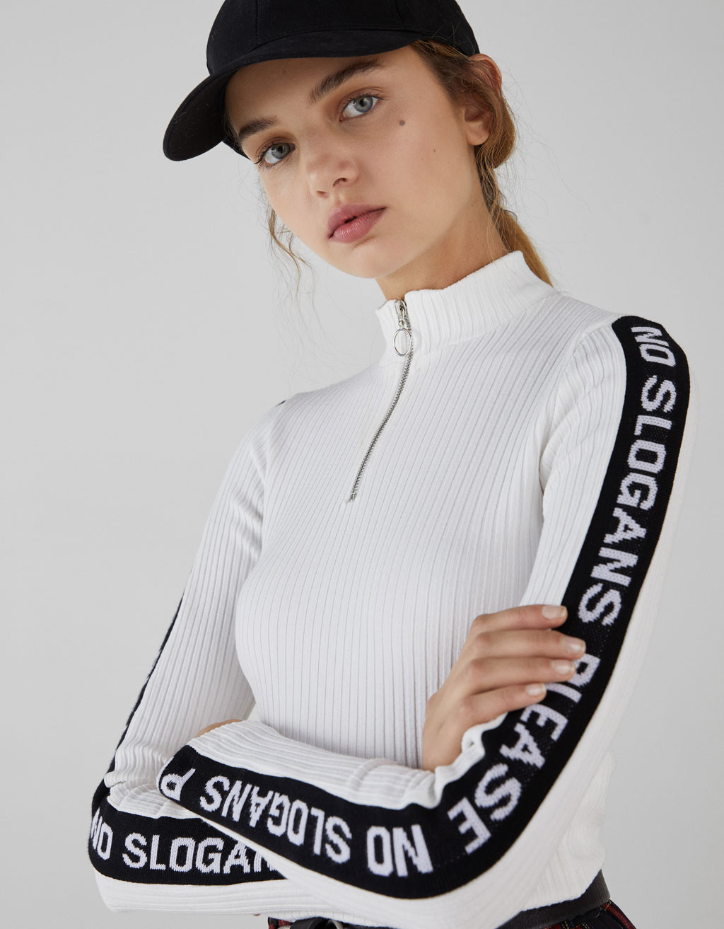 Sweater with side taping