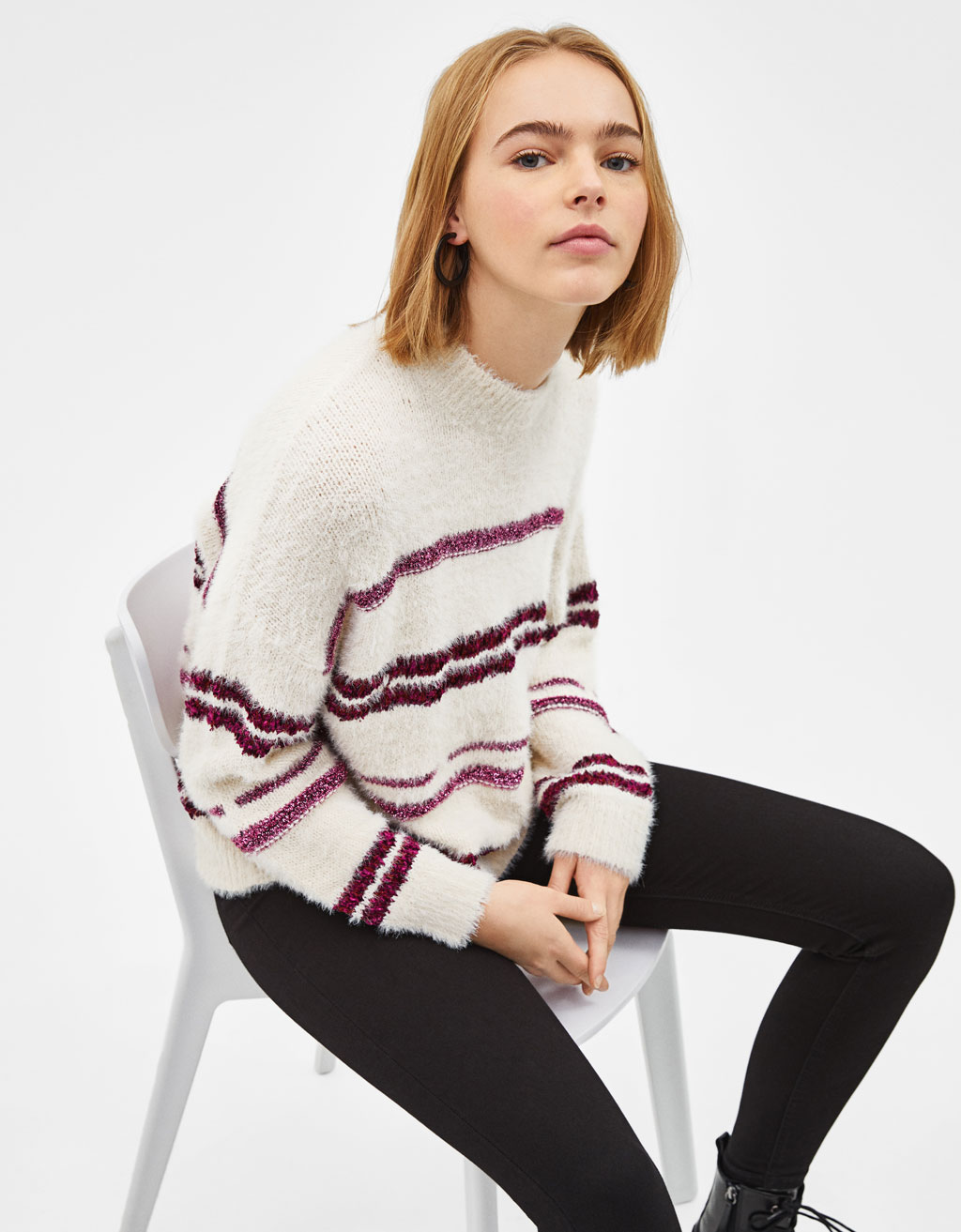 Fuzzy sweater with metallic stripes