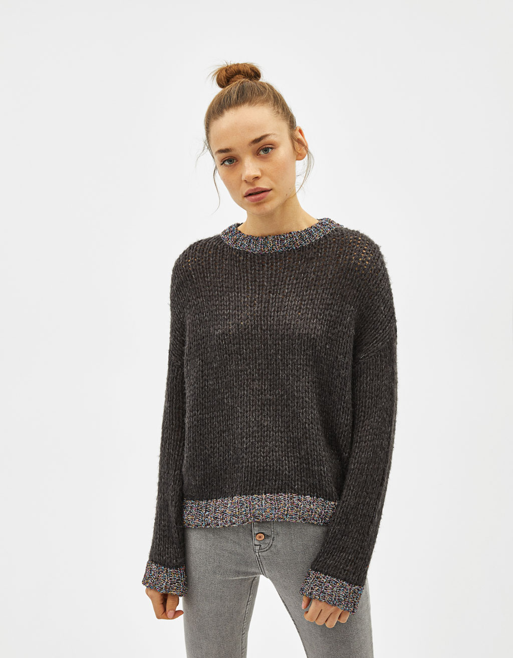 Sweater with metallic thread trims