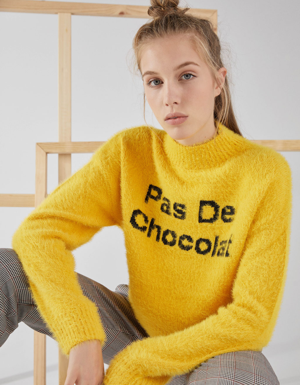 Fuzzy sweater with slogan