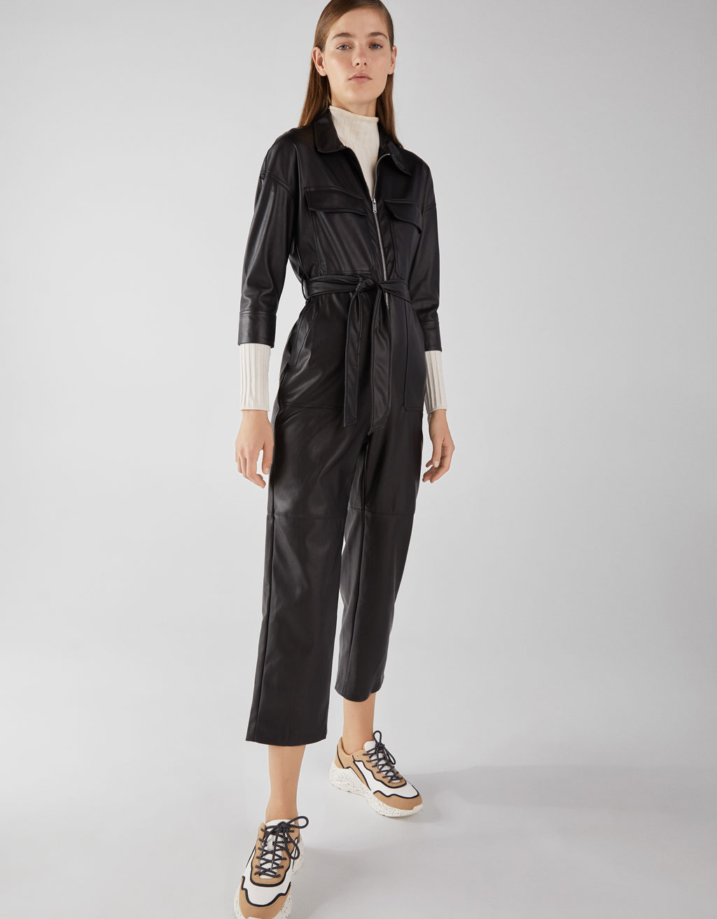 Faux leather jumpsuit with belt