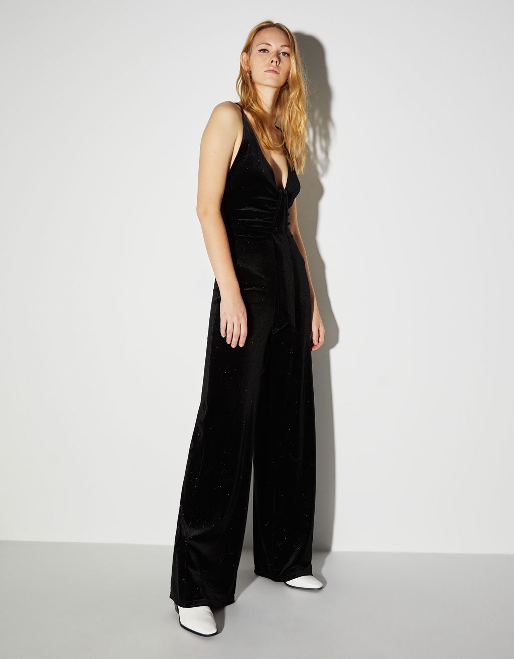 Low-cut jumpsuit with glitter