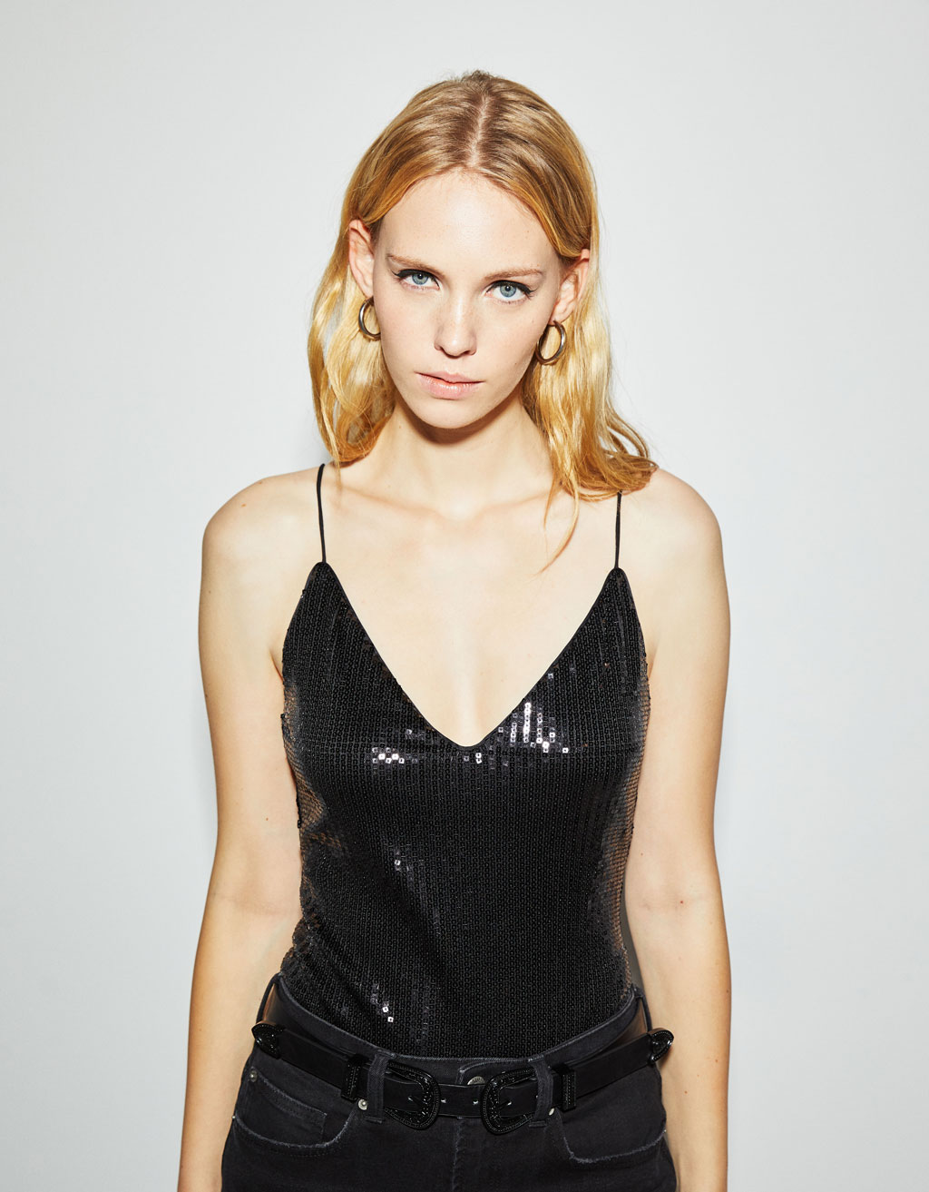 Sequined bodysuit with crossed straps