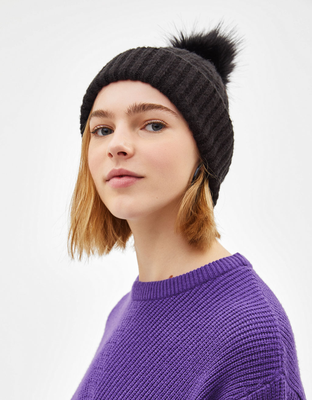 Hat with fluffy pompom