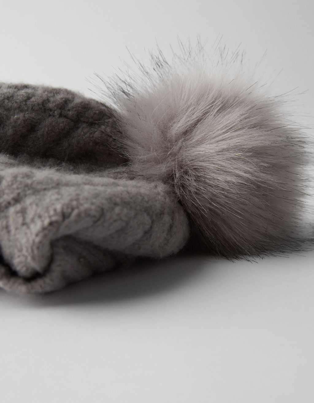 Hat with faux fur pompom