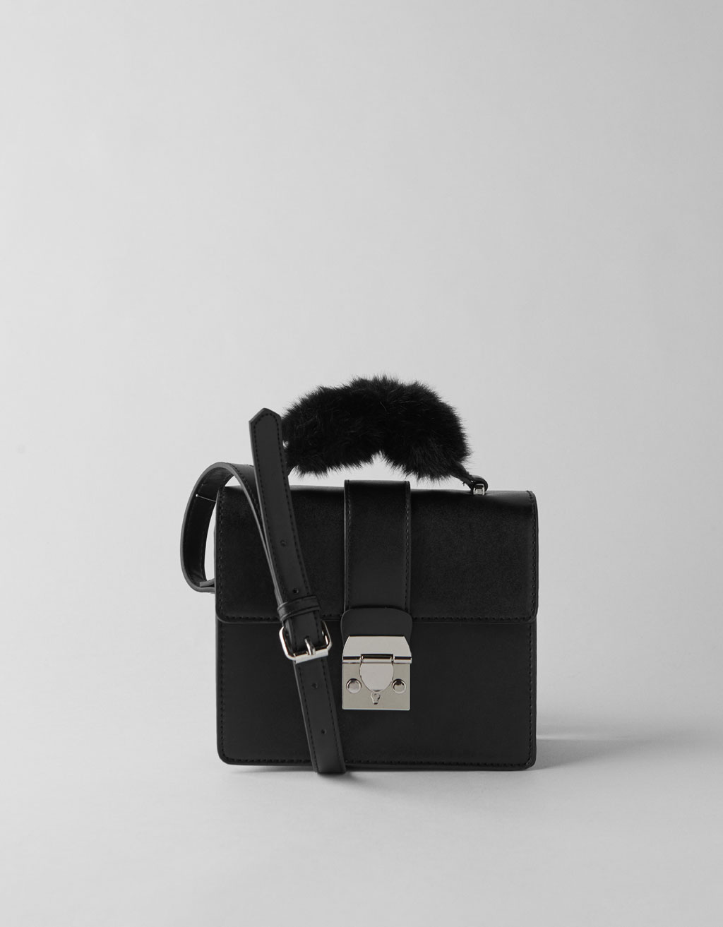 Faux leather bag with fuzzy strap
