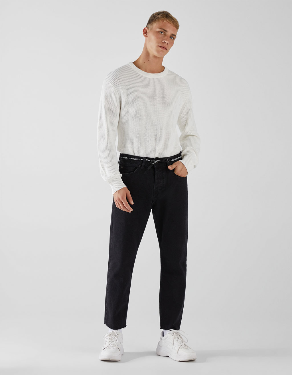 Cropped slim fit jeans with tied string detail