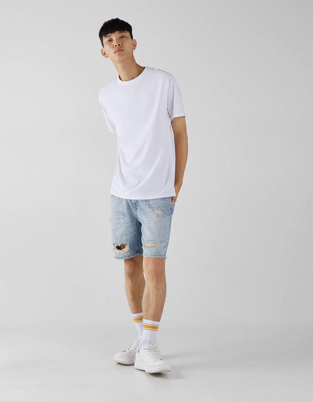 Slim fit vintage Bermuda shorts with faded effect