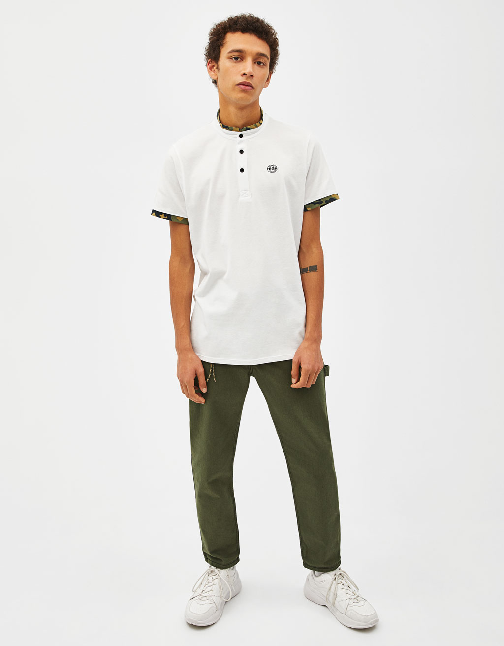 Polo shirt with a camouflage stand-up collar