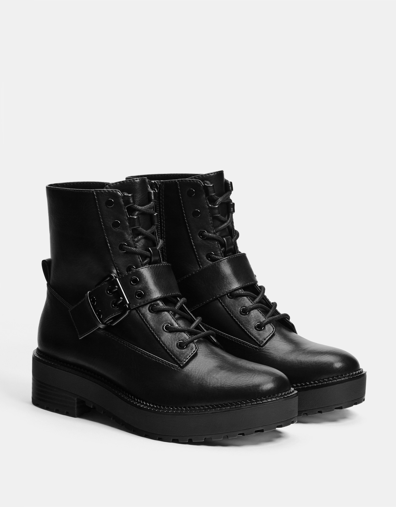 Flat ankle boots with buckled strap