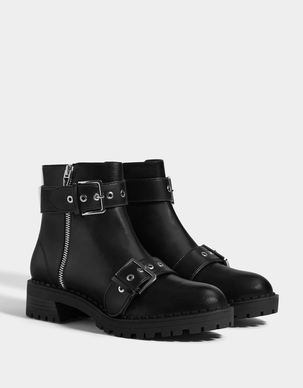 Flat ankle boots with buckles