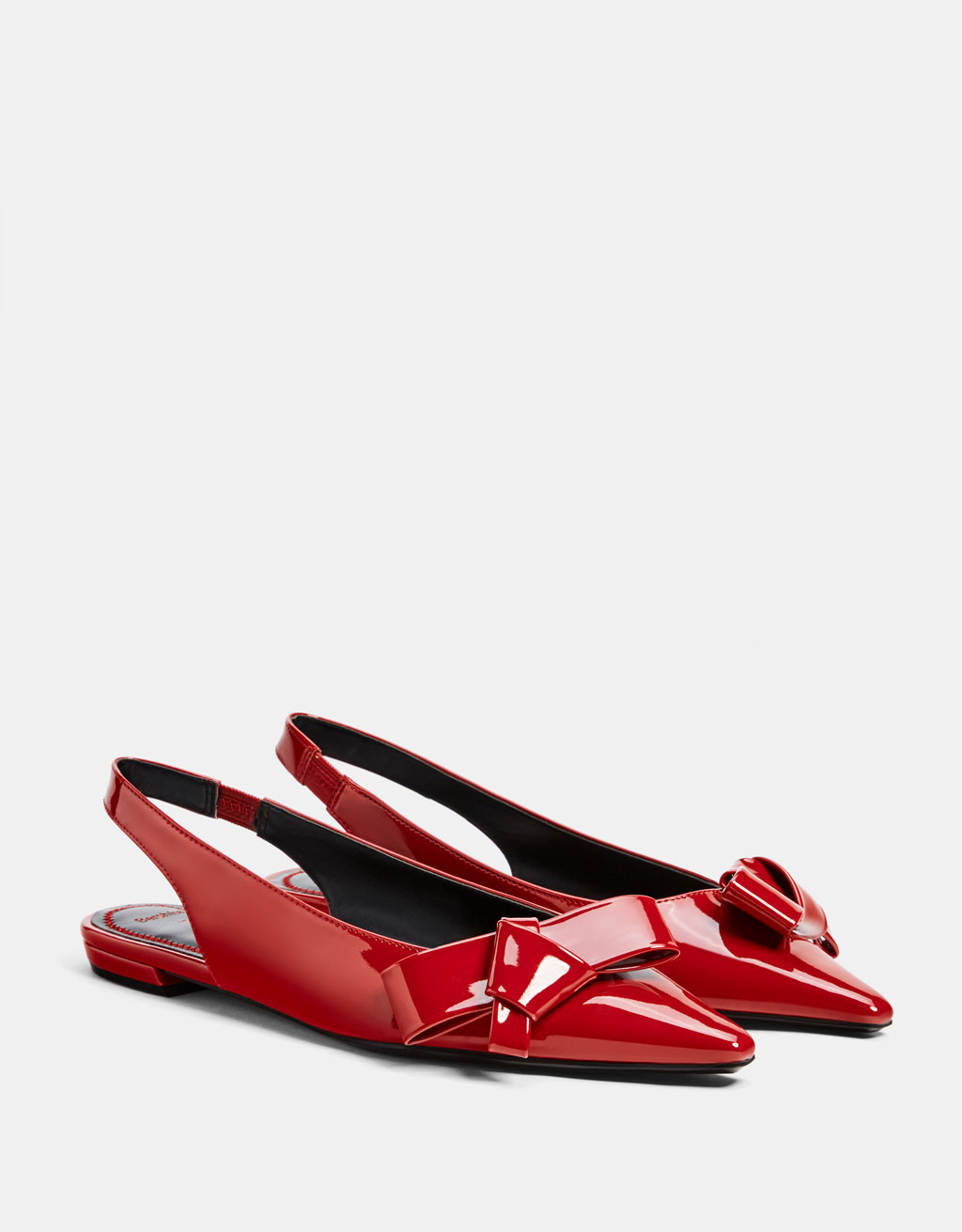 Faux patent leather ballet flats with bow detail
