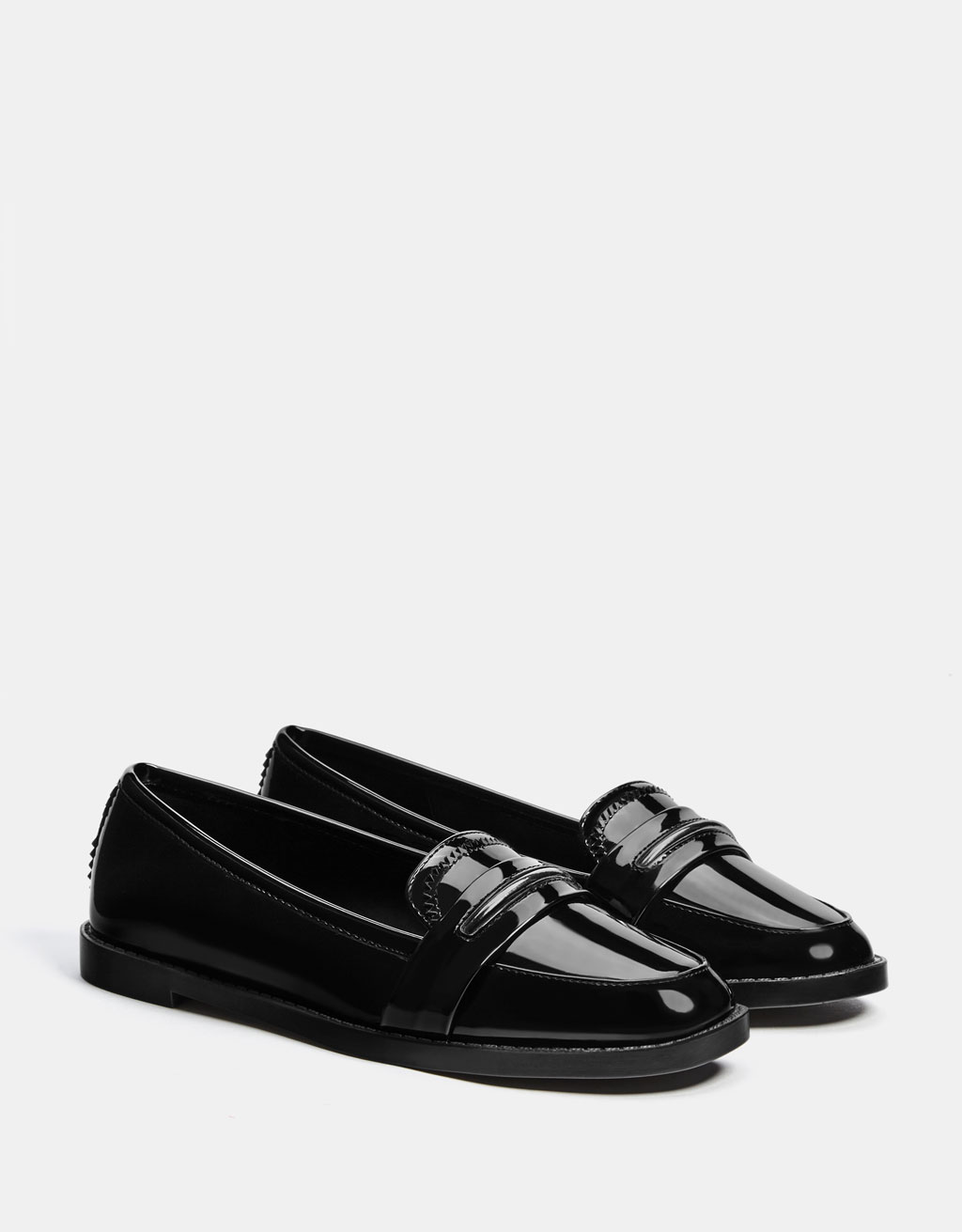 Black loafers with a faux patent finish