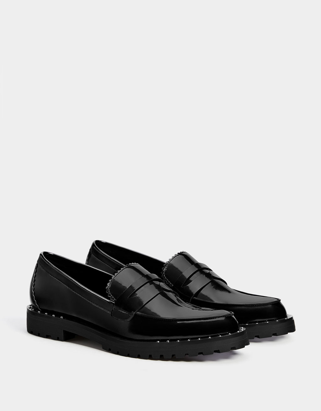 Black faux patent leather penny loafers with studs