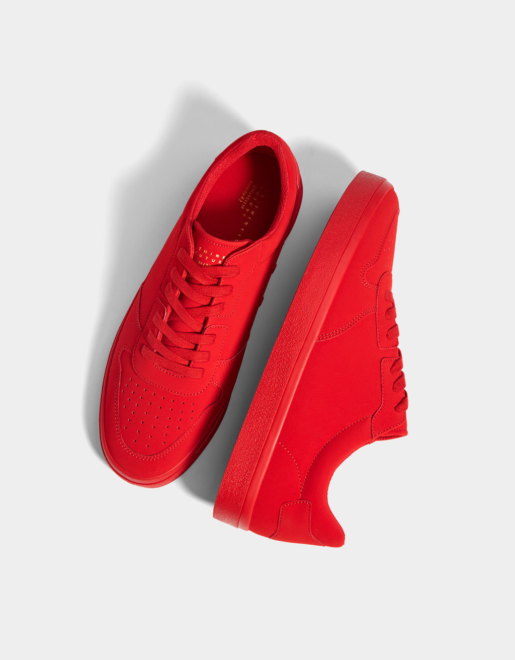 Red monochrome trainers