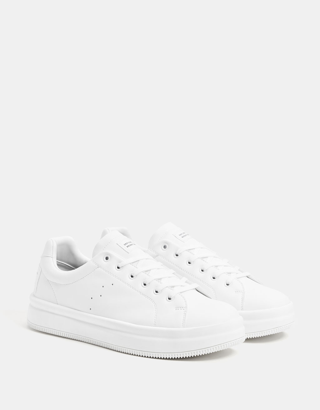 Monochrome sneakers with slogan