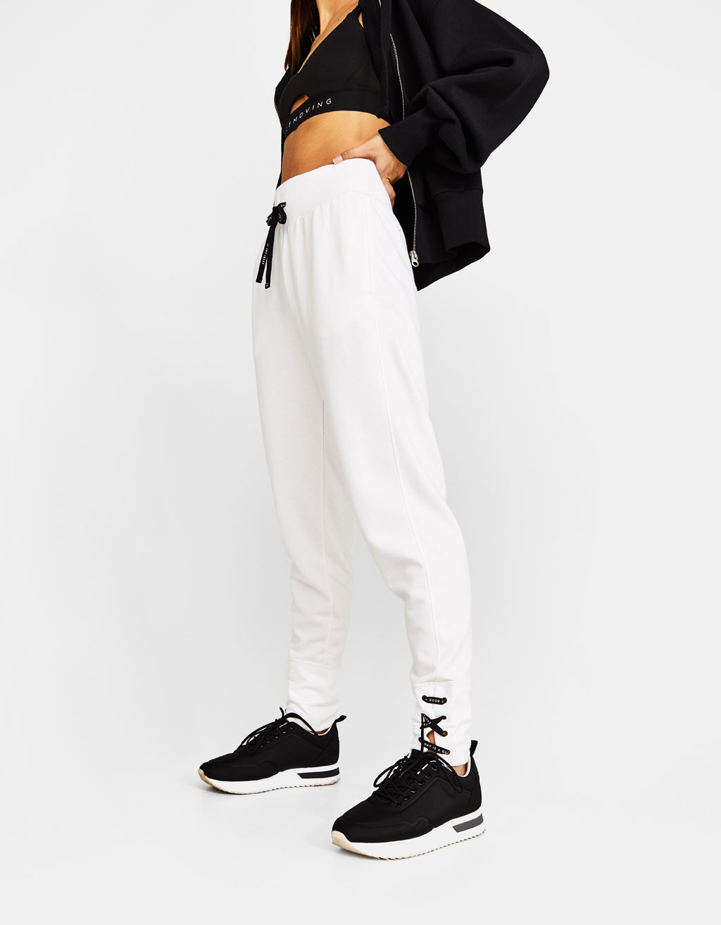 Sports joggers with criss-cross ties at hem