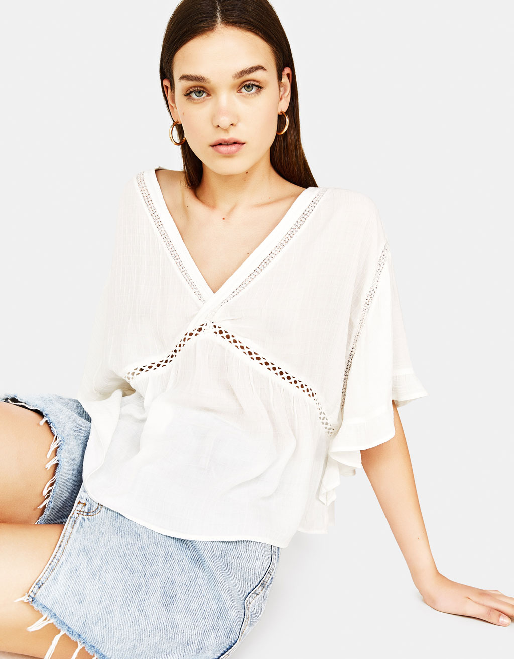 Oversized blouse with lace trims