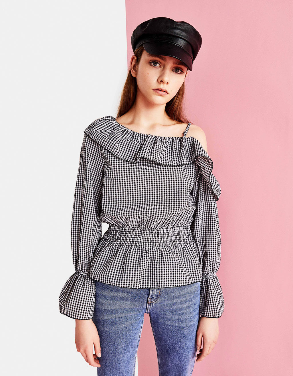 Shirt with asymmetric ruffled neckline