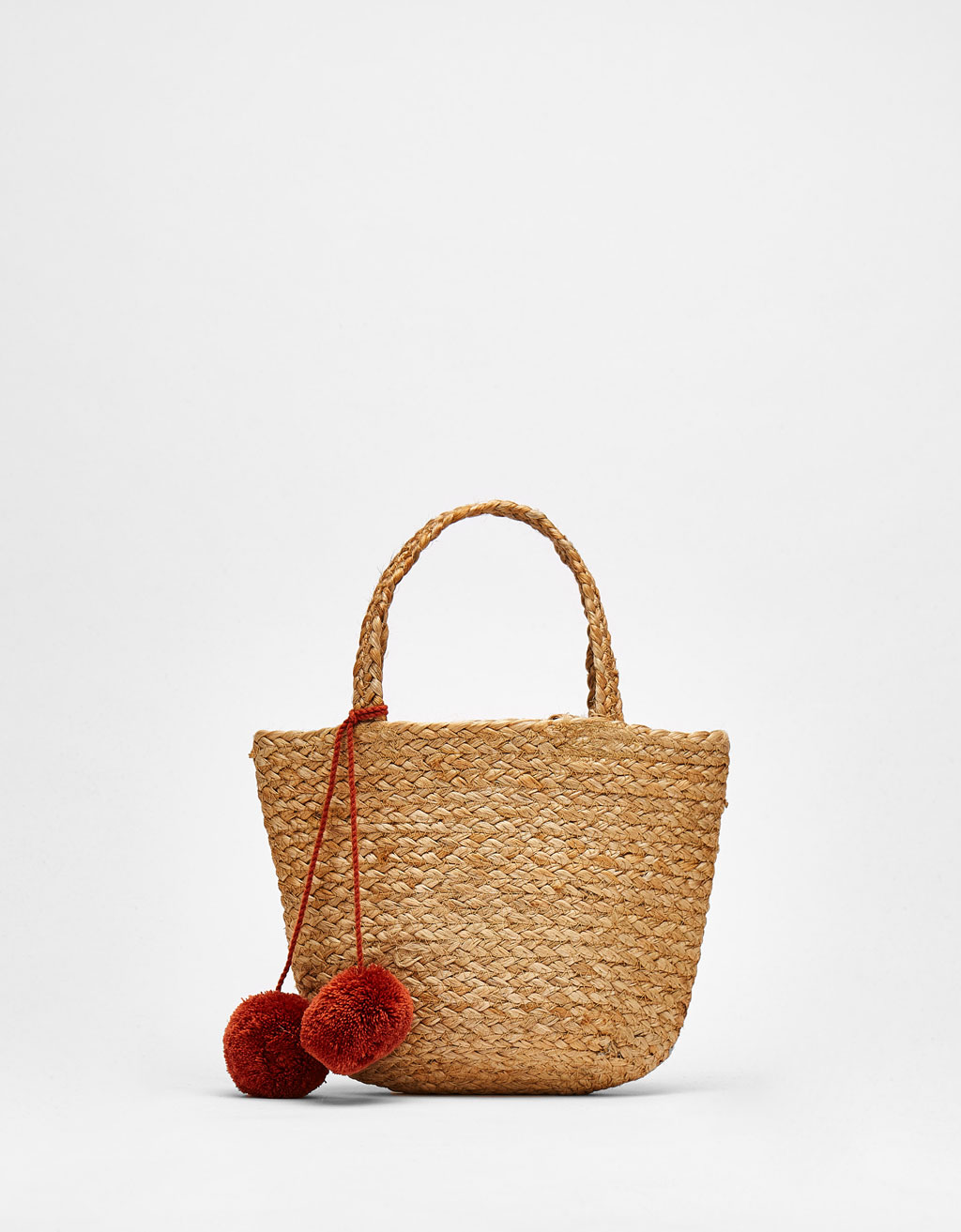 Raffia basket bag with pompoms