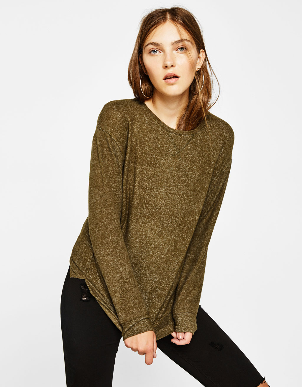 Knit sweater with seams