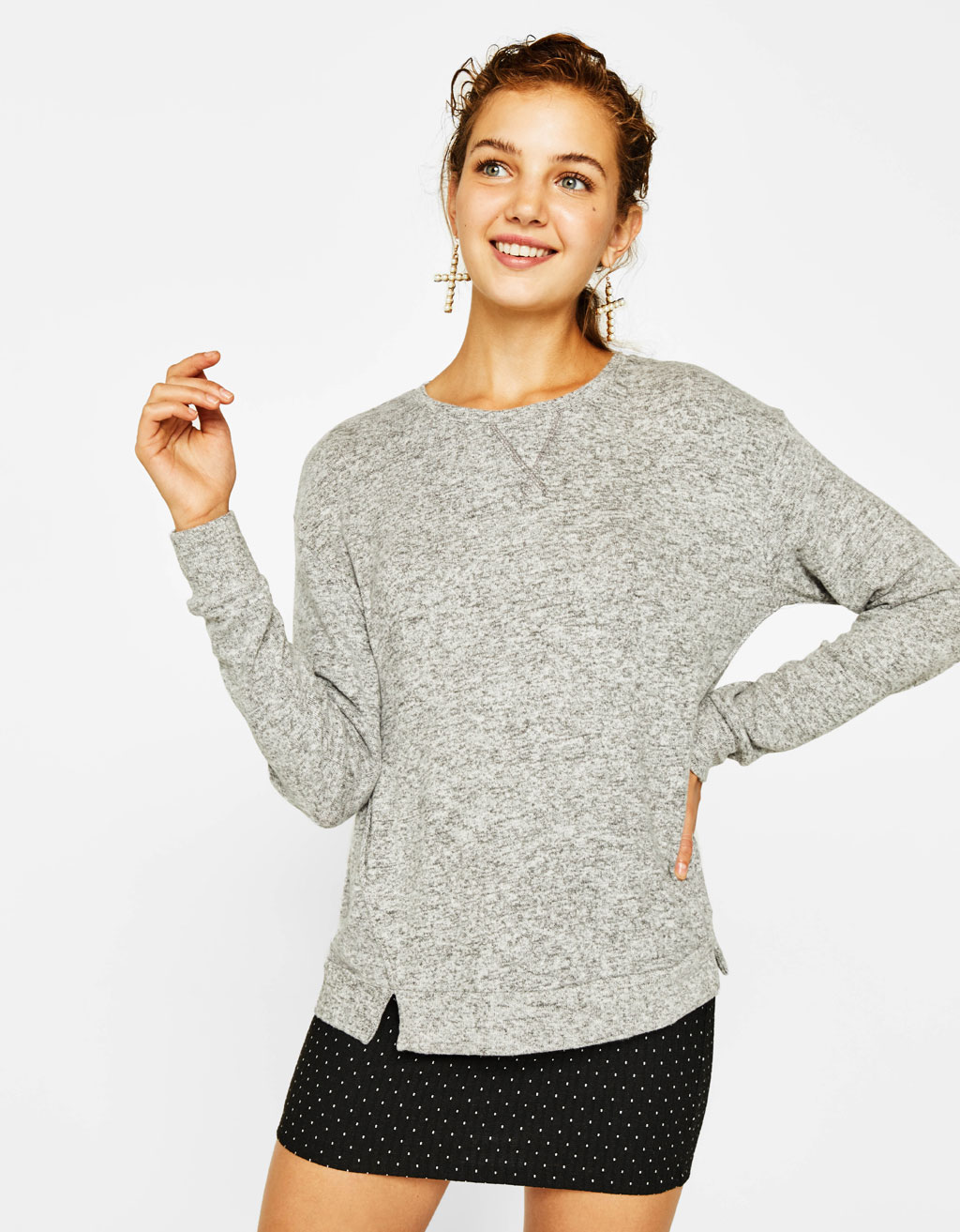 Pull maille coutures