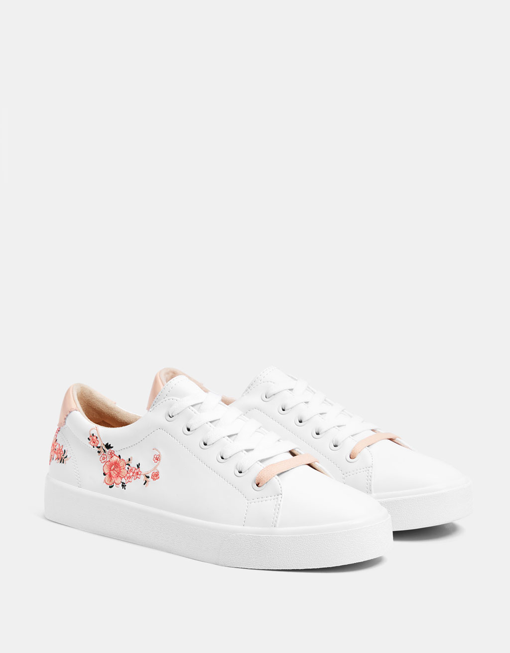 Embroidered white trainers