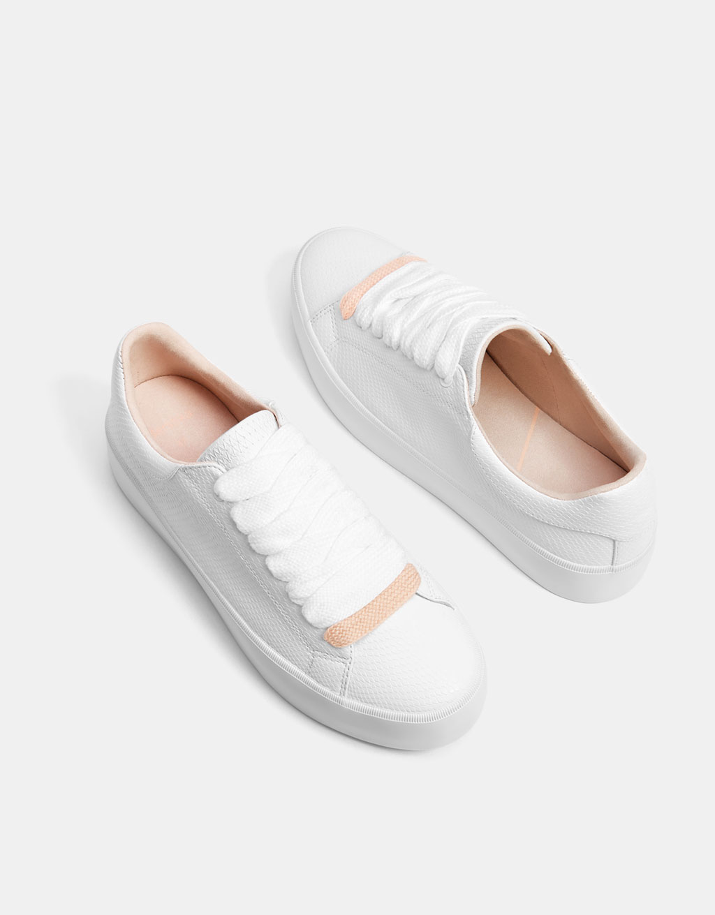 Embossed white sneakers