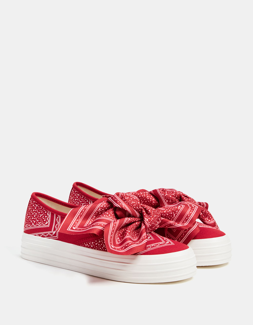 Red trainers with bow detail