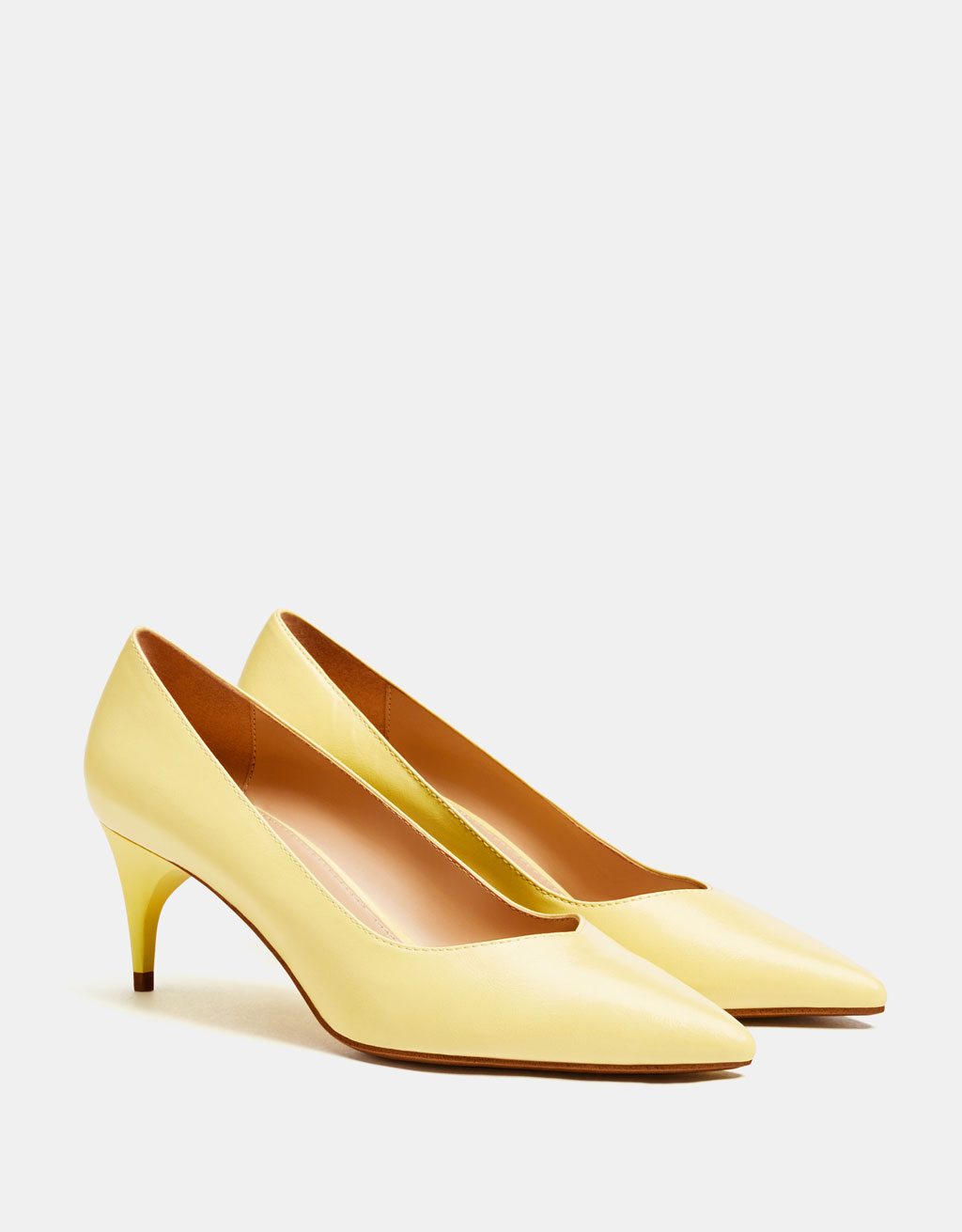 Yellow mid-heel shoes