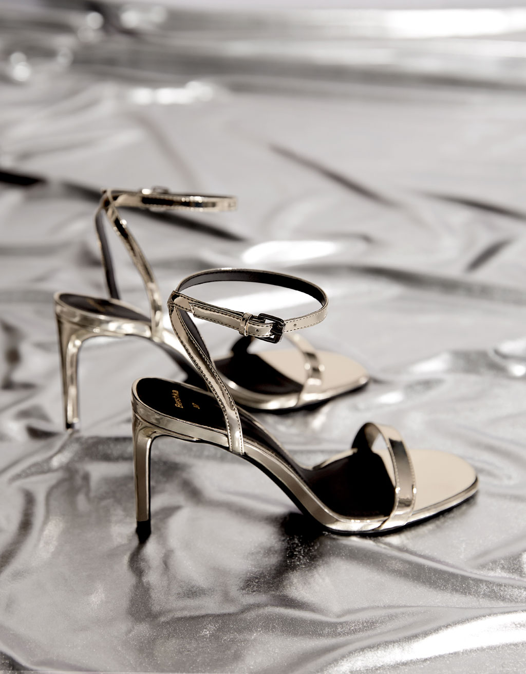 Metallic sandals with stiletto heels