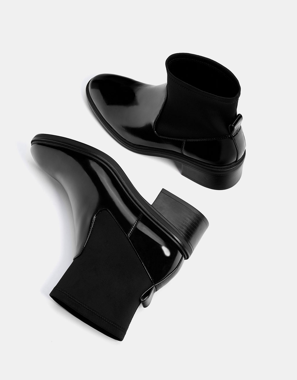 Elastic sock-style and faux patent ankle boots