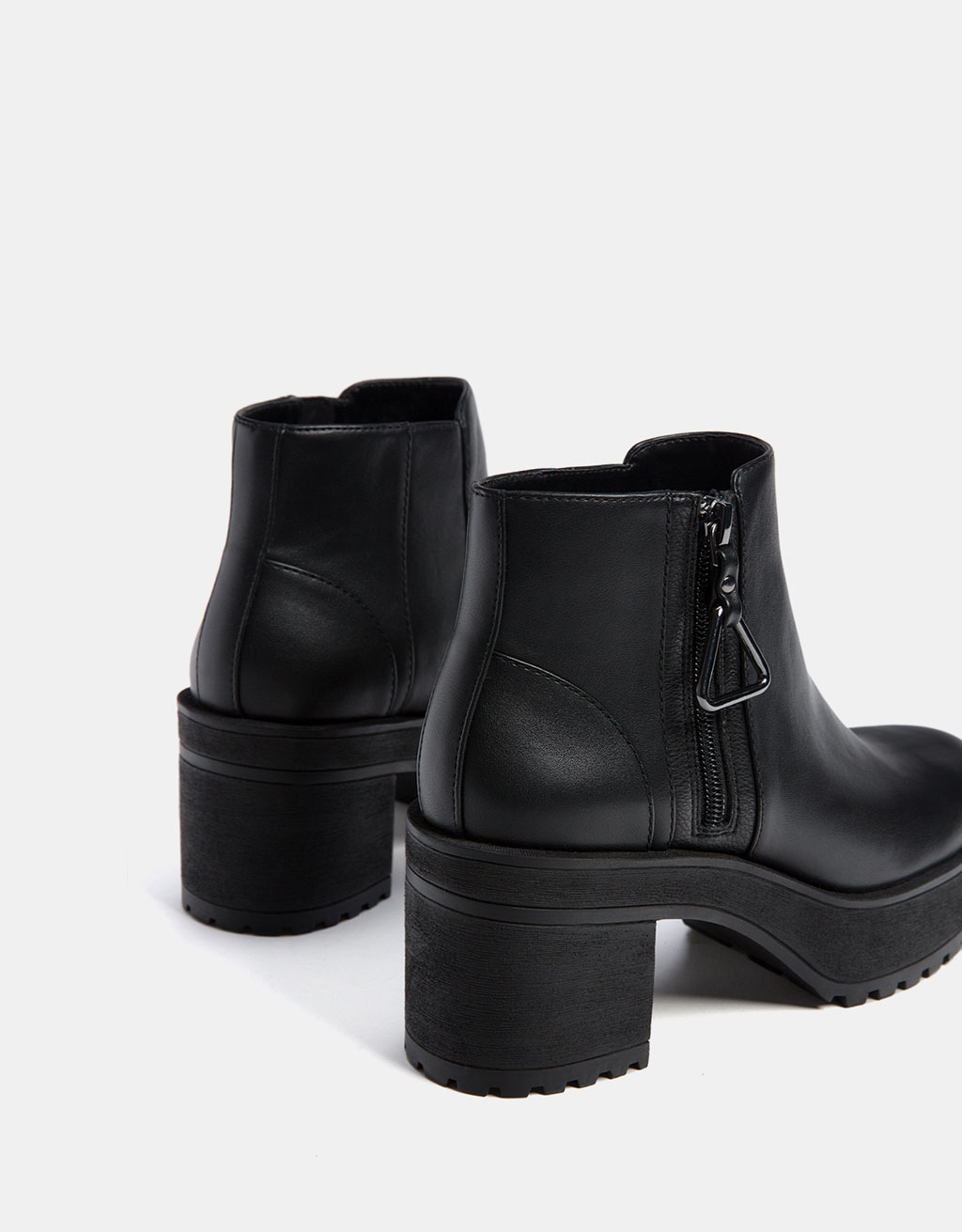 Mid heel platform ankle boots with zip pull detail