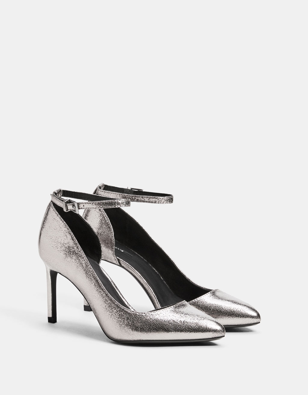 Asymmetric metallic high heel shoes with ankle straps