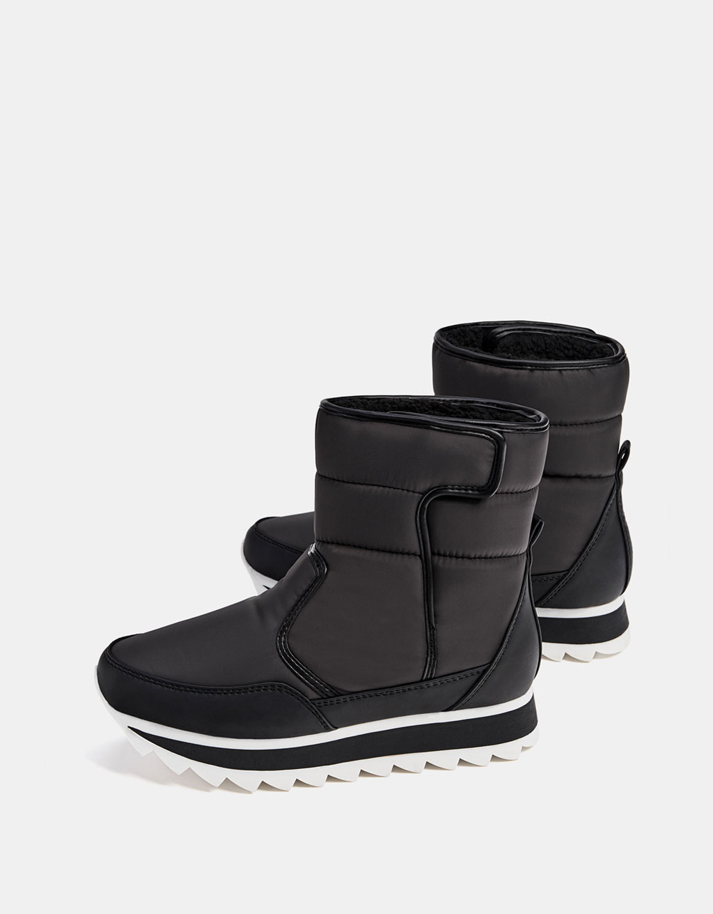 Quilted technical ankle boots with lining
