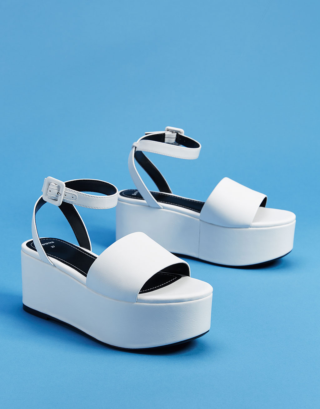 White faux patent leather platform sandals