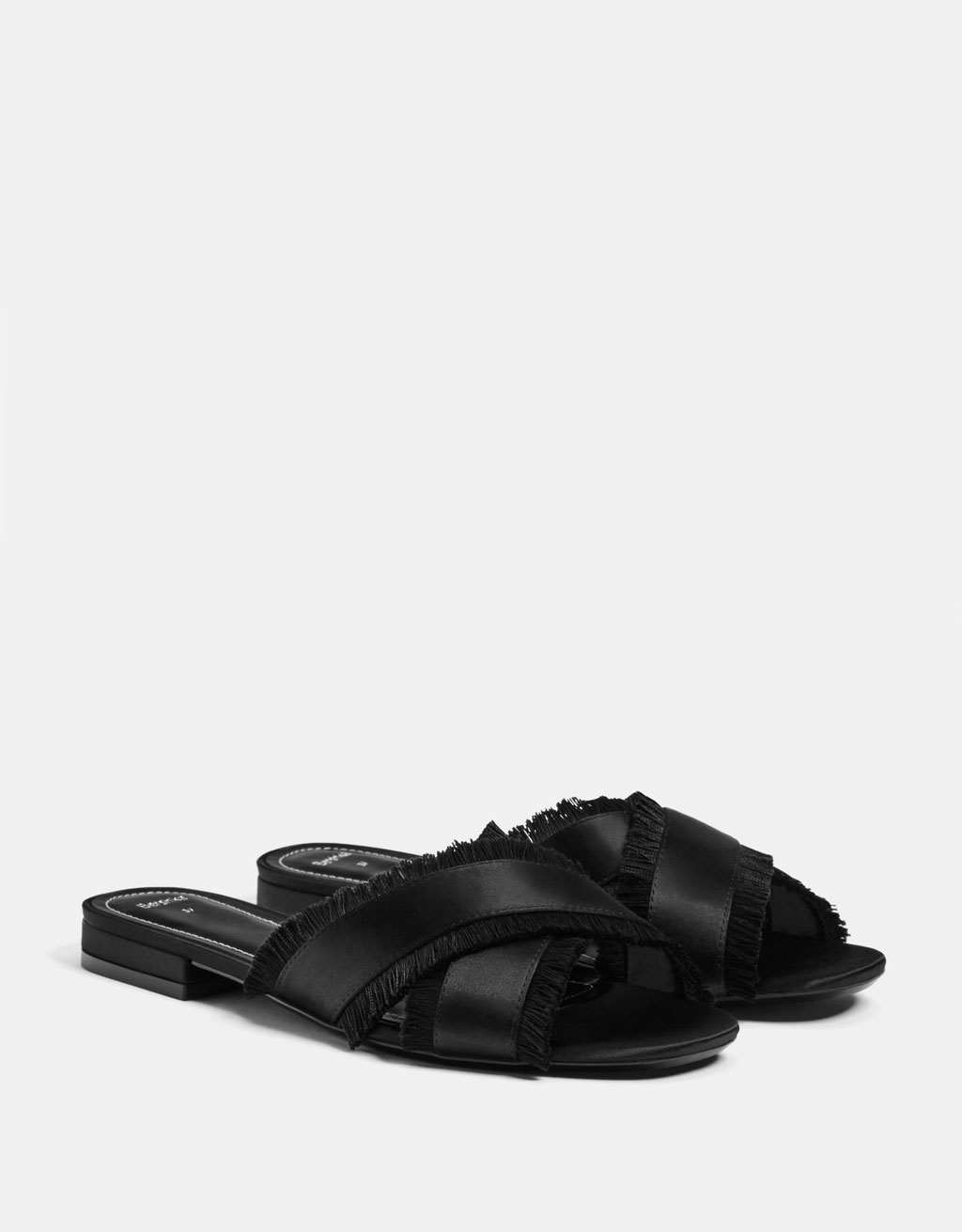 Slides with fringed crossover straps