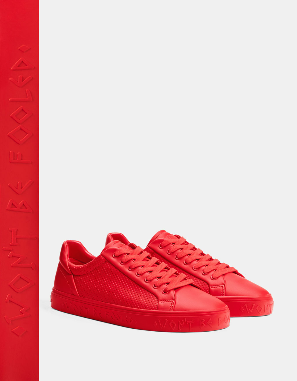 Men's red perforated trainers