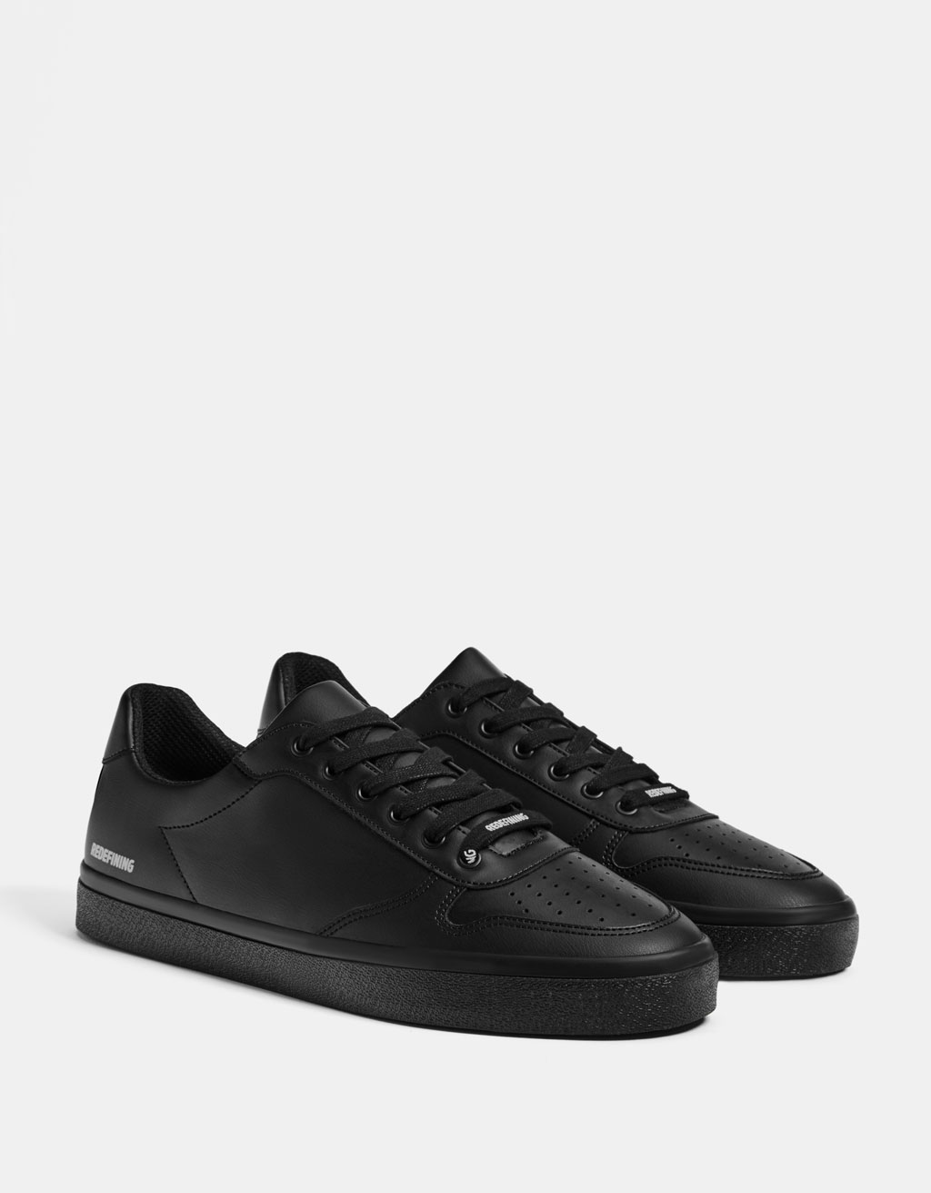 Men's black monochrome sneakers with slogan