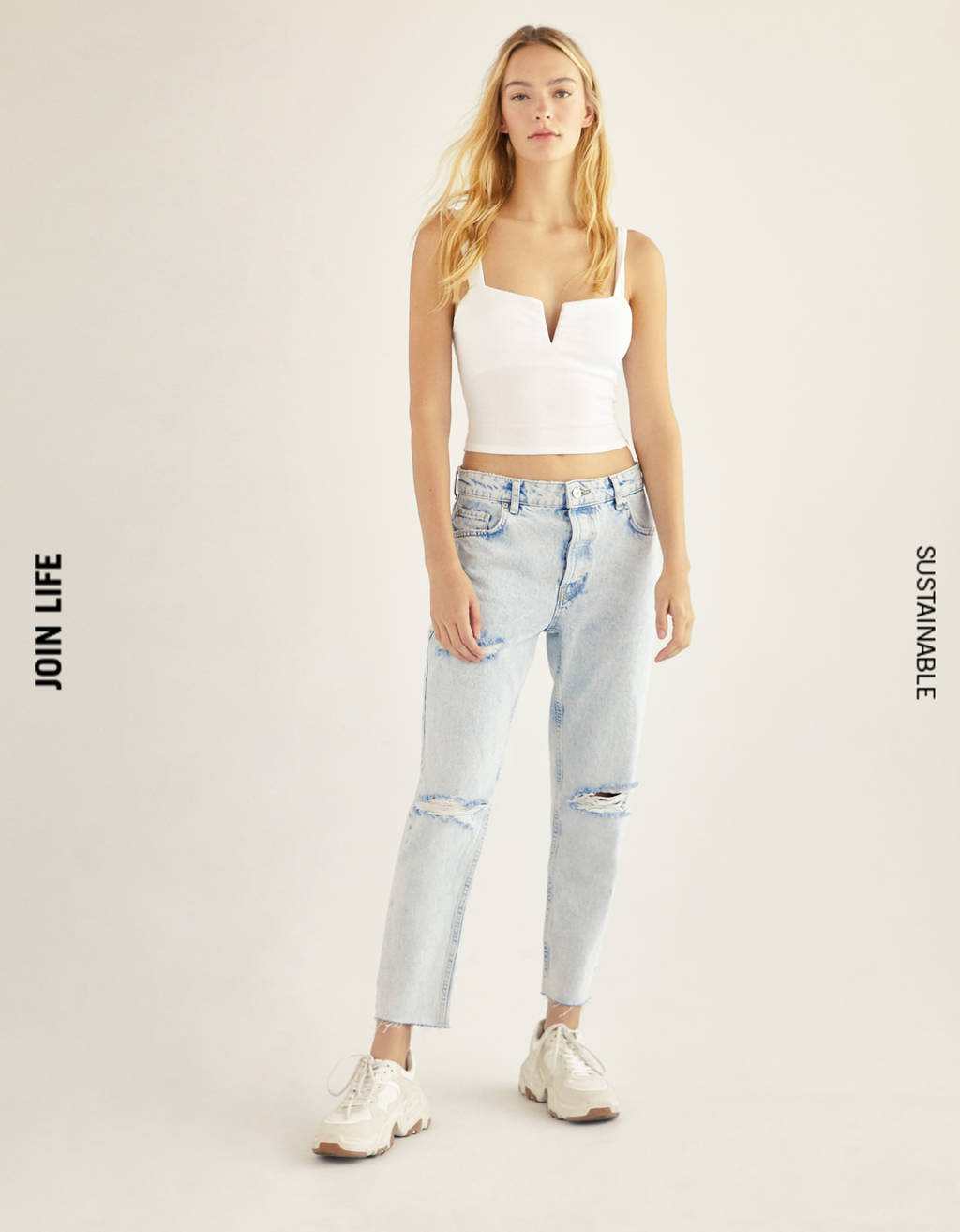 Top with straps and low neckline