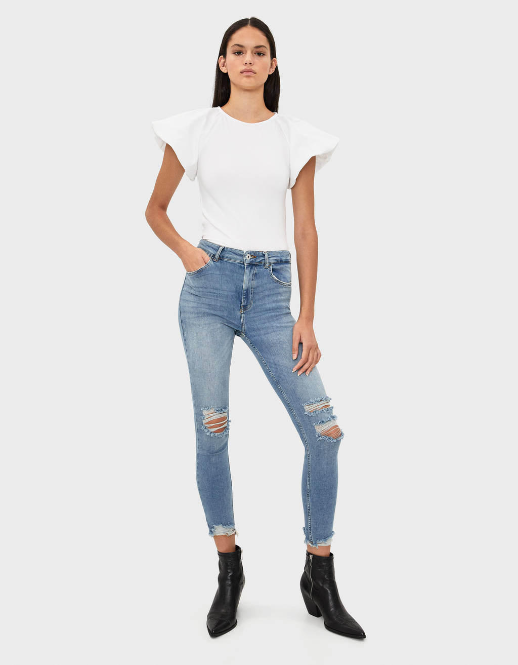 High-rise skinny jeans with rips