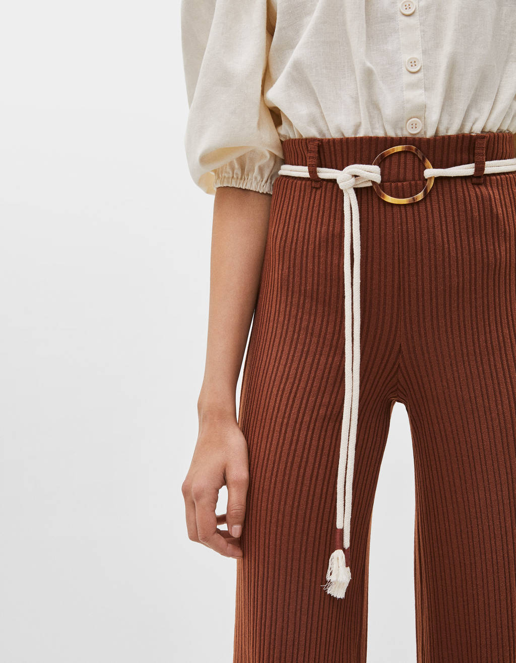Flared trousers with belt