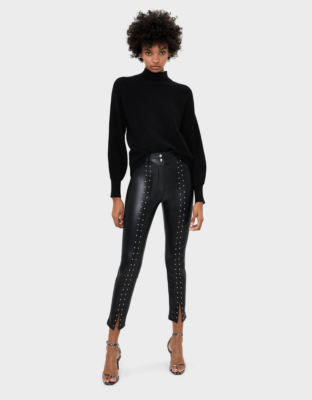 Faux leather trousers with studs