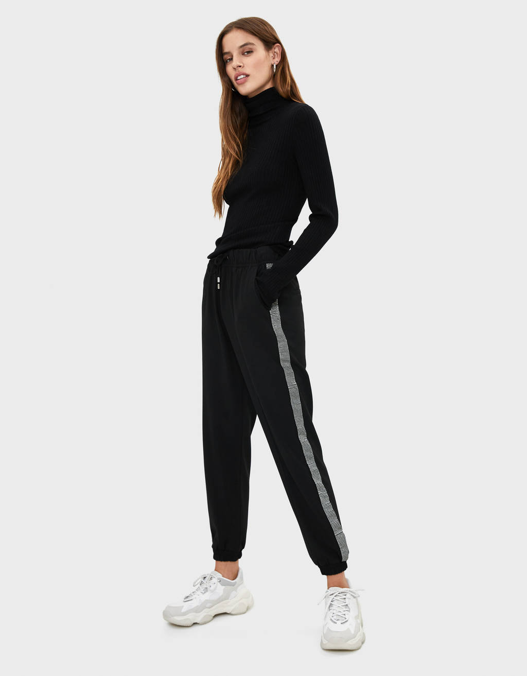 Jogging trousers with shimmer side stripes