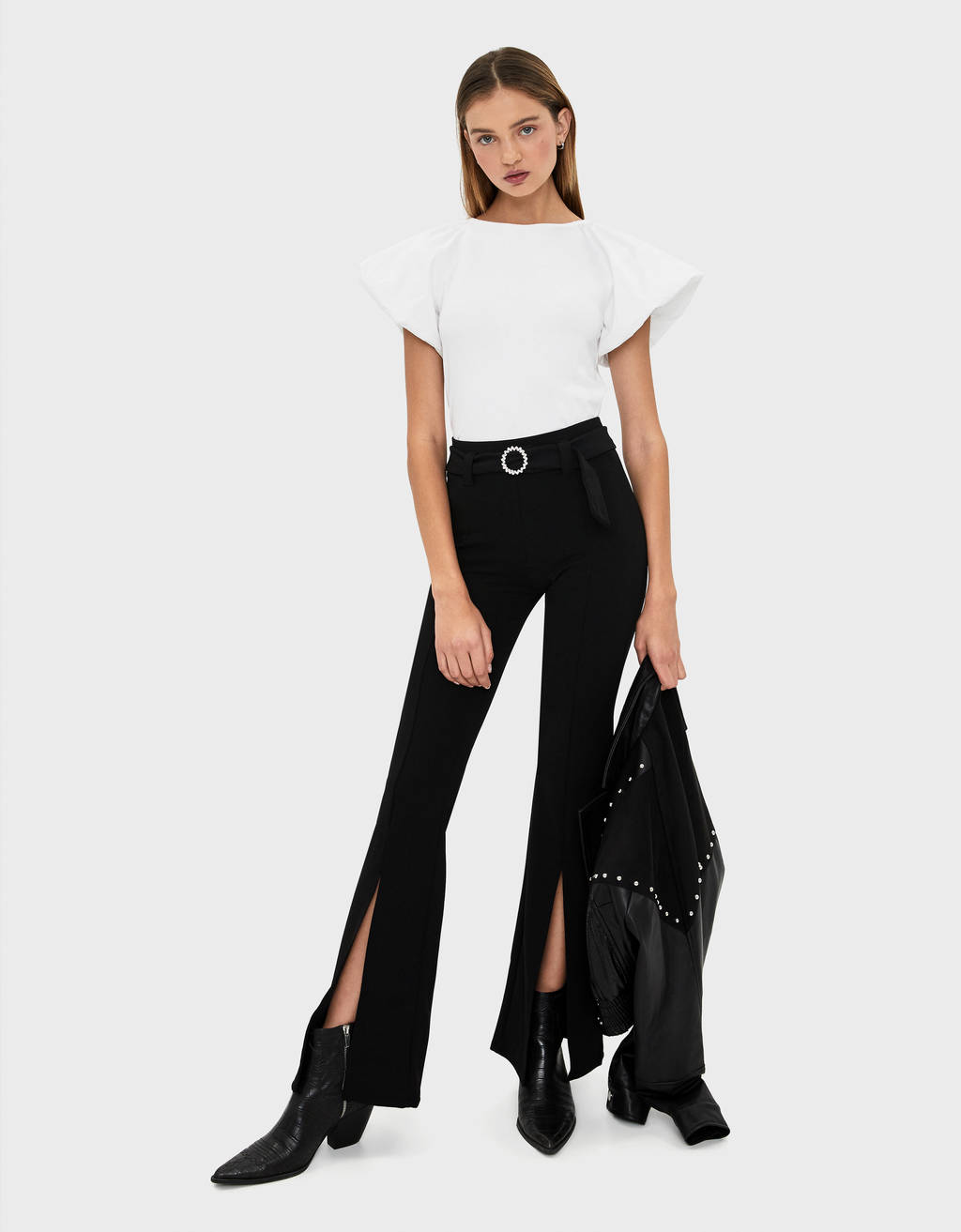 Flared trousers with buckle