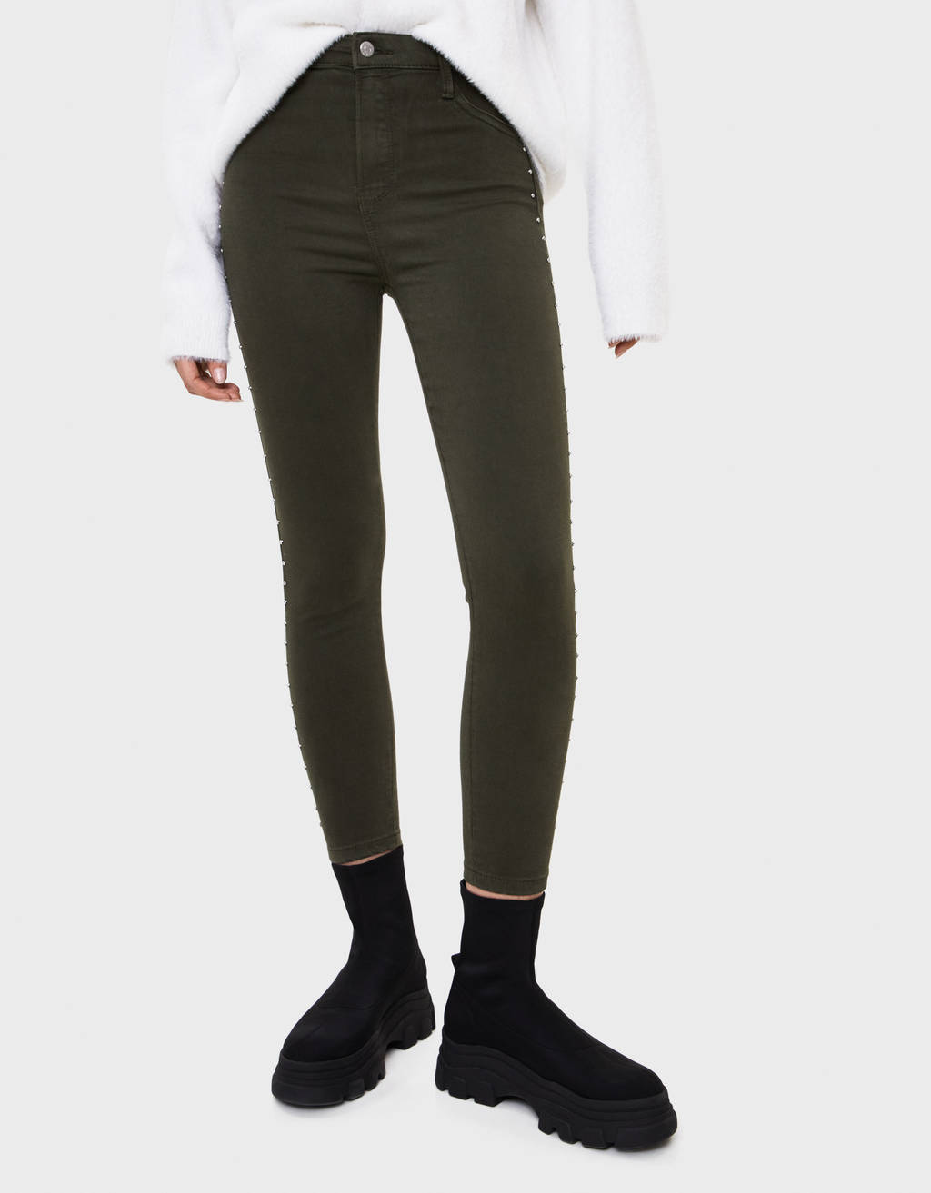 Trousers with studded taping